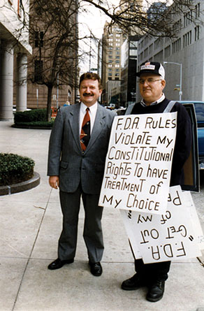 Dr. Stanislaw Burzynski and a patient with a sign