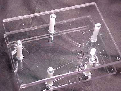"""Figure 3. Soap film realization of """"MacGyver"""" Solution for five-node system."""