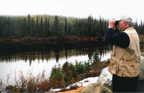 Joe Nickell looking through binoculars