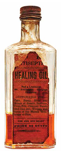 old, weathered bottle of 'healing oil'
