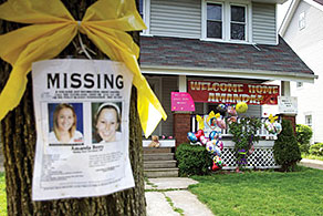 Welcome Home Amanada sign and Missing poster