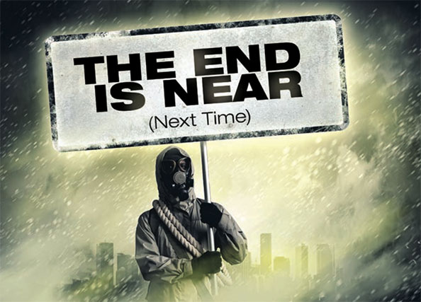 Man in gas mask holding sign that reads THE END IS NEAR (Next Time)