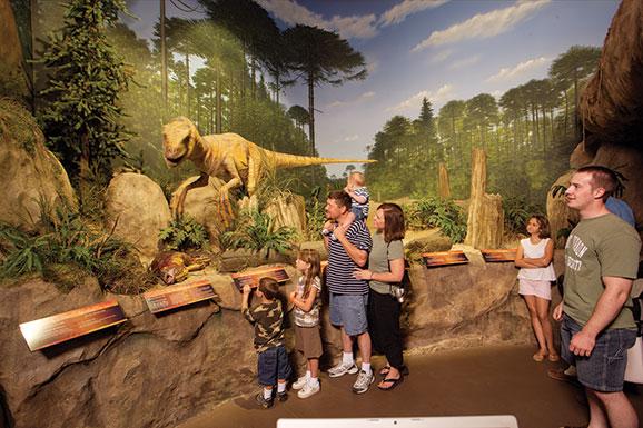 family at dinosaur museum exhibit