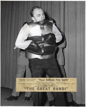 The Great Randi tied up in a straitjacket